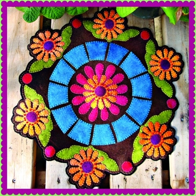 Lazy Daisy Summer Afternoon floral candle mat or penny rug showcases  beautifully designed applique crafted in buttery soft hand dyed wool in vibrant color.
