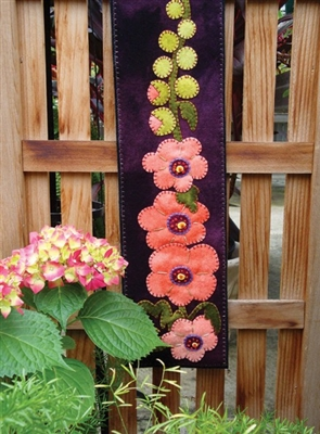 Bring summer indoors with this delightfully casual summer hollyhock wall hanging, appliqued in buttery soft wool.